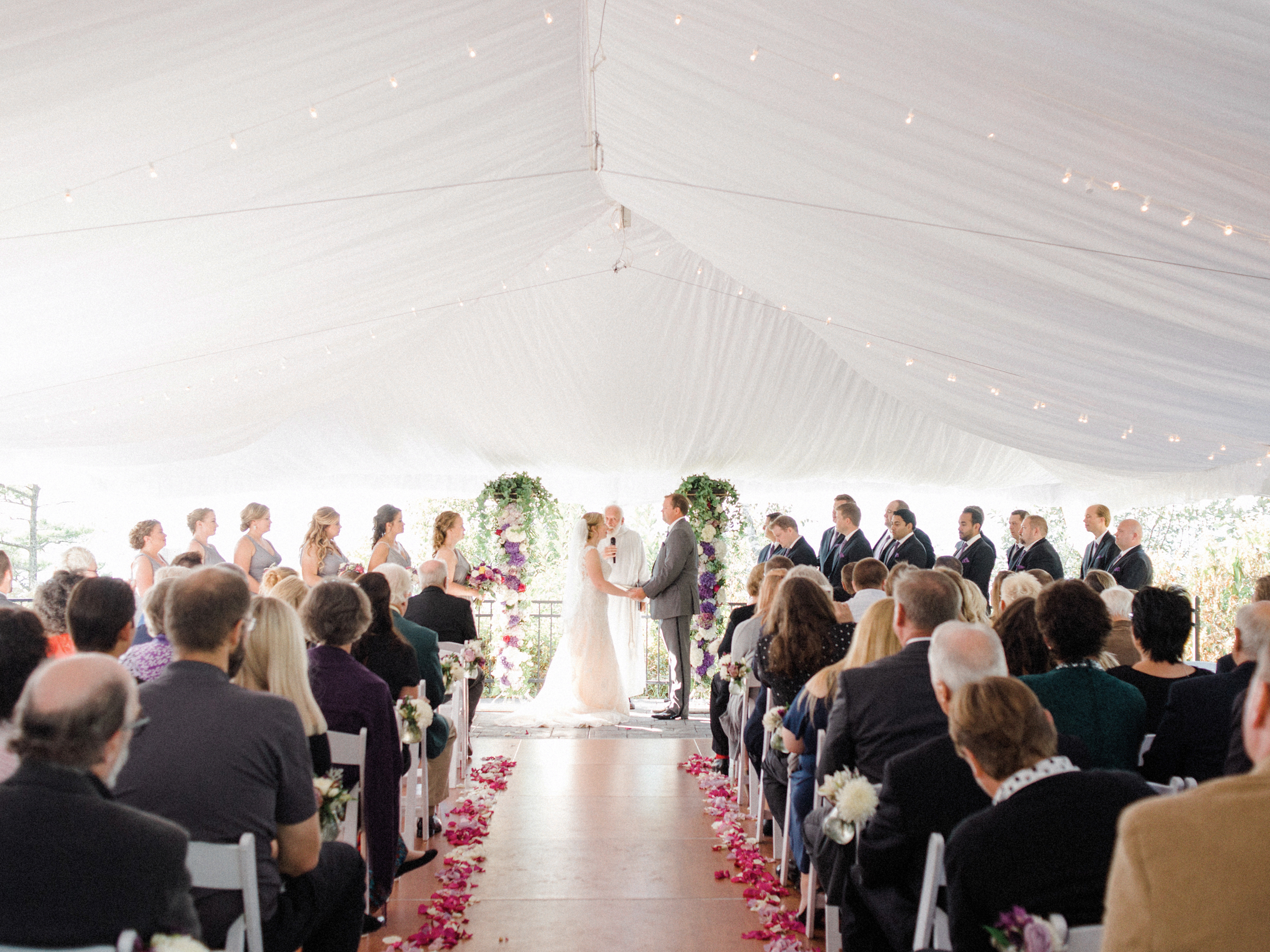 white tent wedding ceremony at horseshoe bay golf club