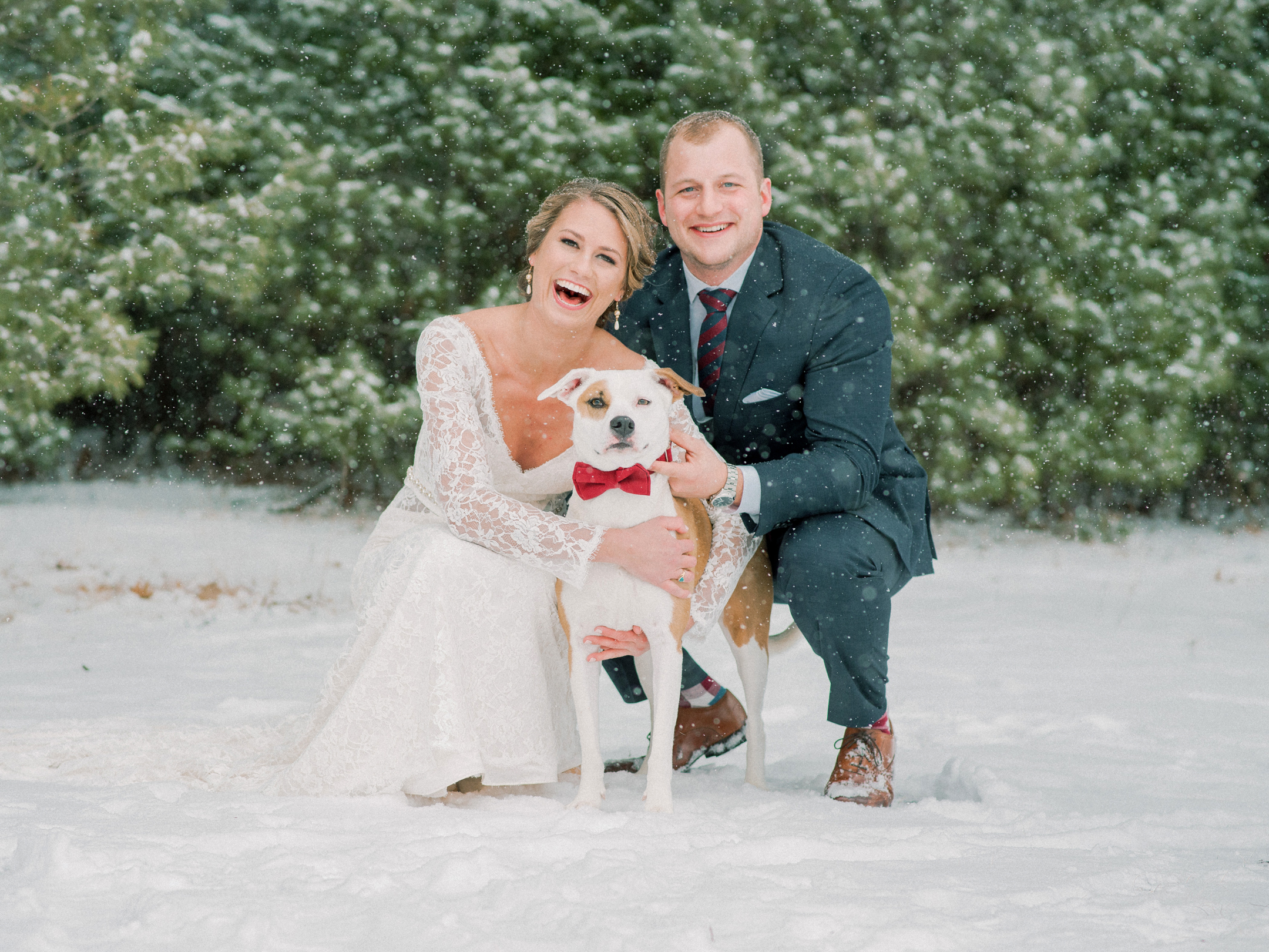 bride and groom with their dog ring bearer