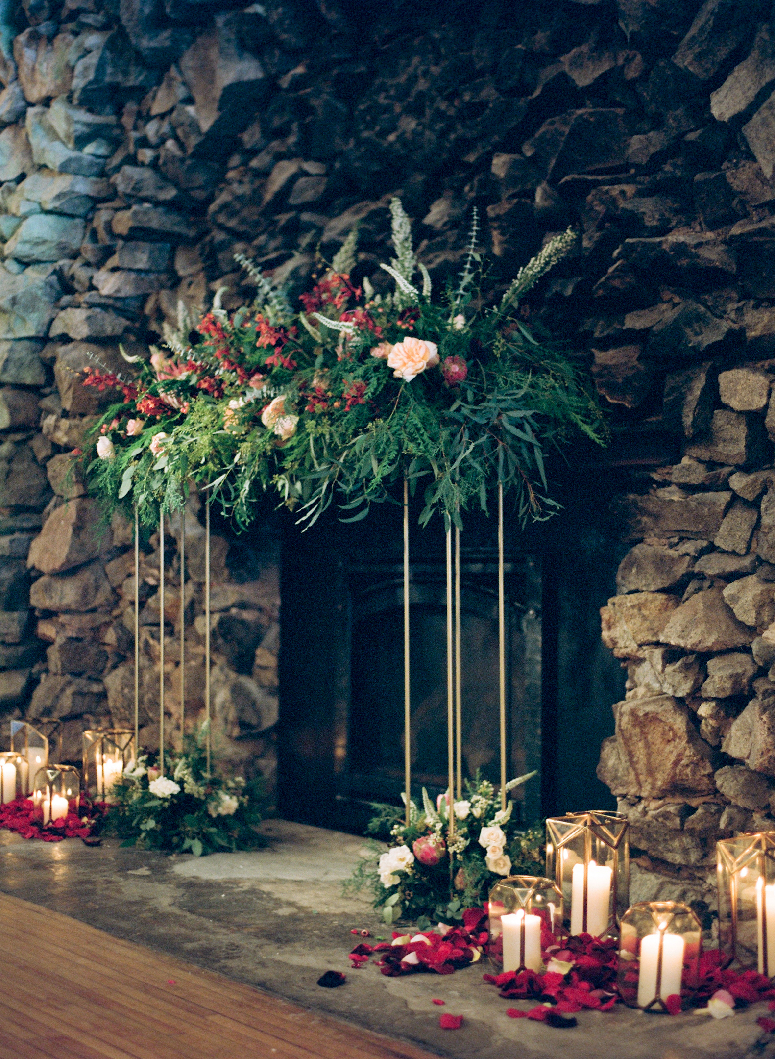Grand fireplace floral arbor at Rothschild Pavilion winter wedding