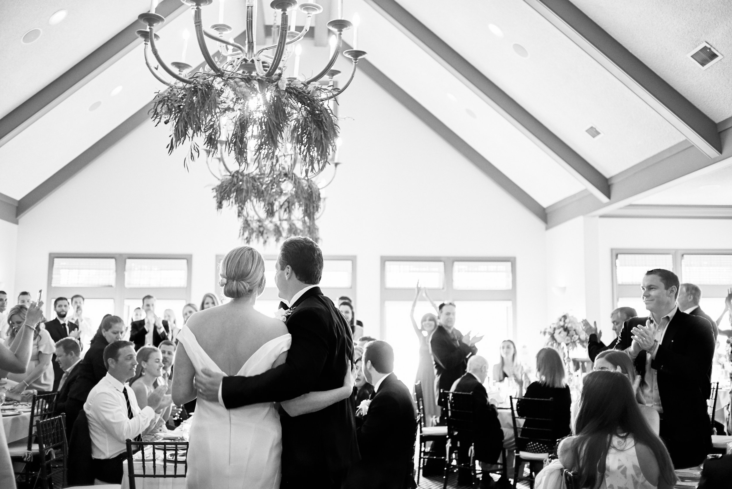 bride and groom's grand entrance at Horseshoe Bay Golf Club door county wedding