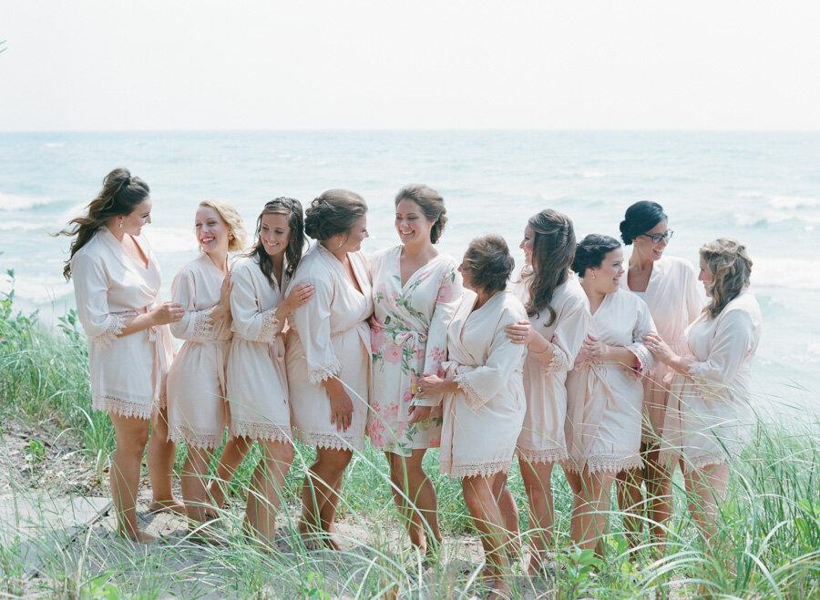 Bridesmaid getting ready robe along lake michigan
