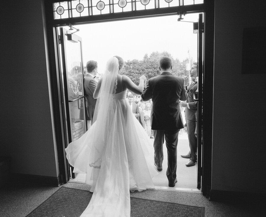 Bride and Groom exit Stella Maris Church in Bailey's Harbor