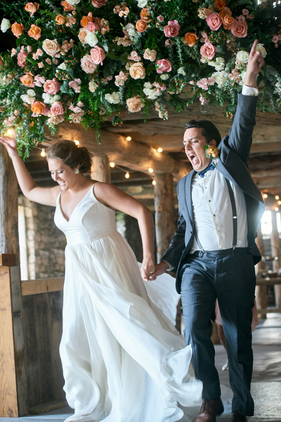 bride and groom enter their reception at about thyme farm door county