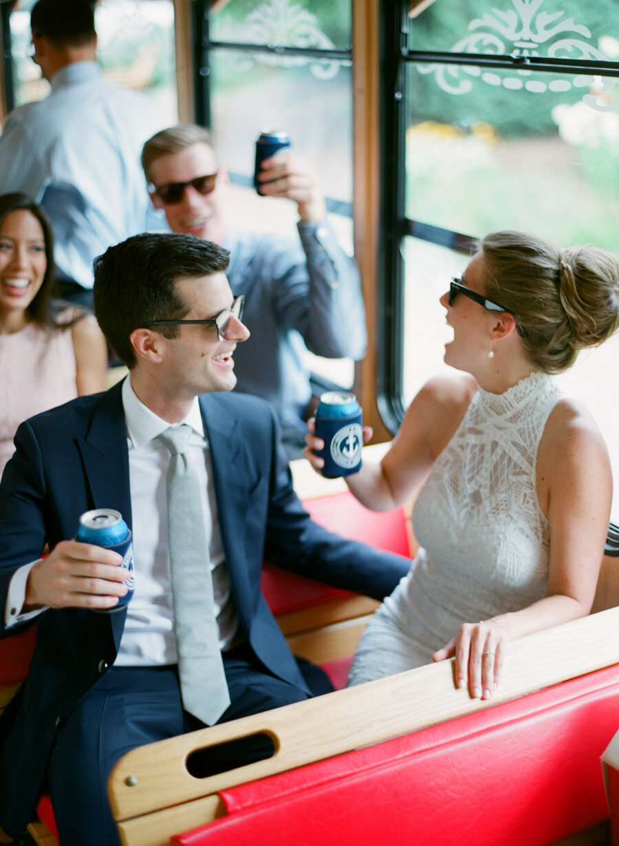 Bride and Groom cheers on a Door County Trolly