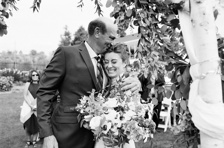 Father walks his daughter down the aisle door county