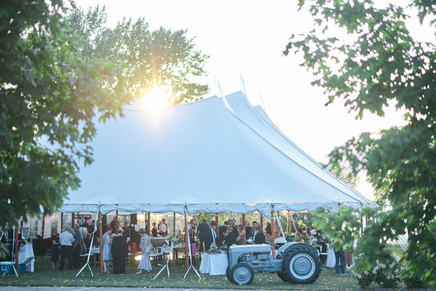 Sail cloth tented reception at sunset in door county