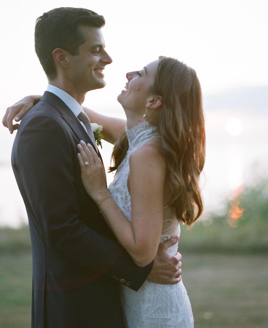 Bride and groom sunset portraits in door county