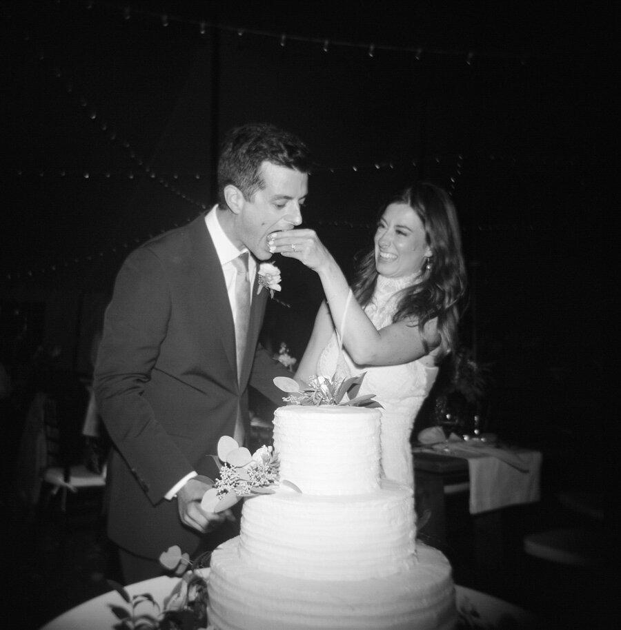 bride and groom cut the cake in door county
