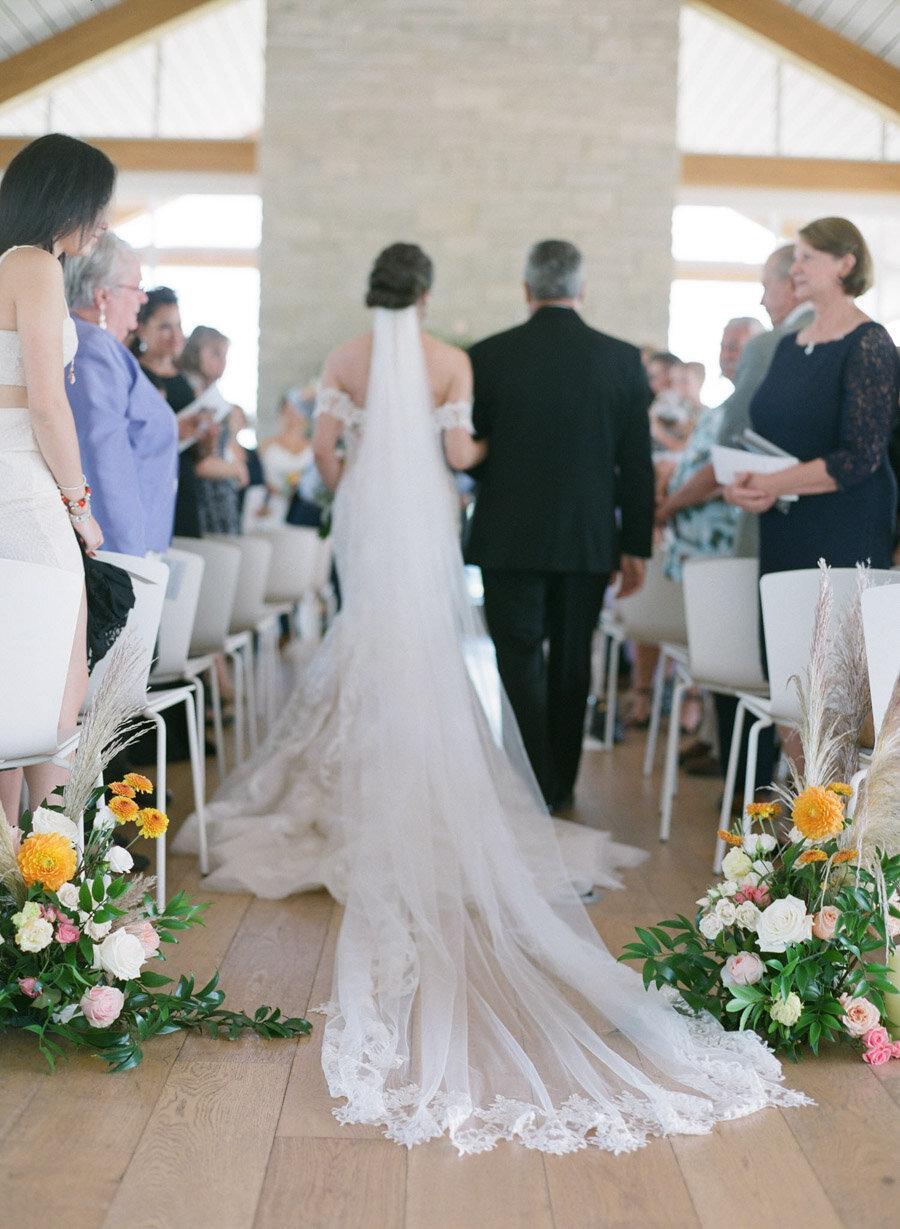 kress pavilion wedding bride walking down the aisle