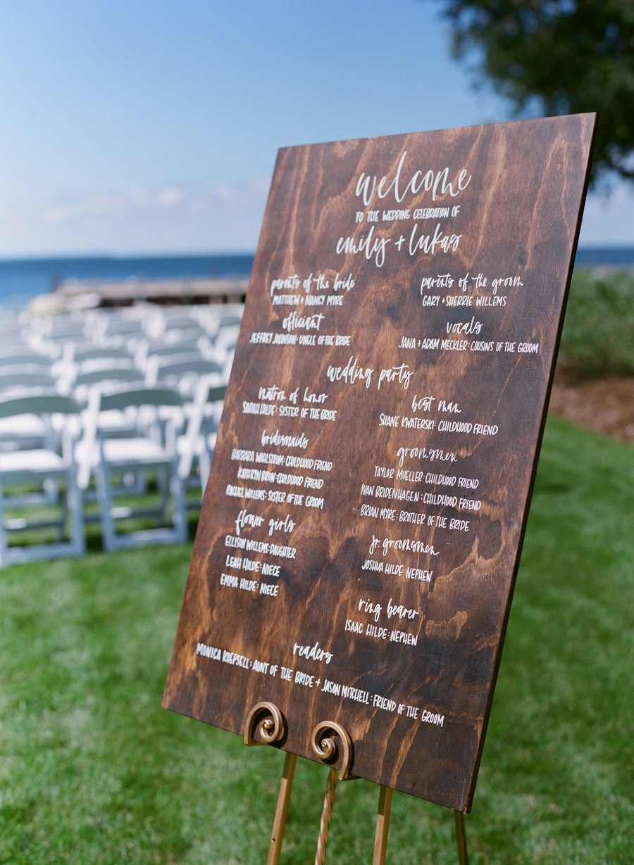 wooden hand lettered wedding sign door county