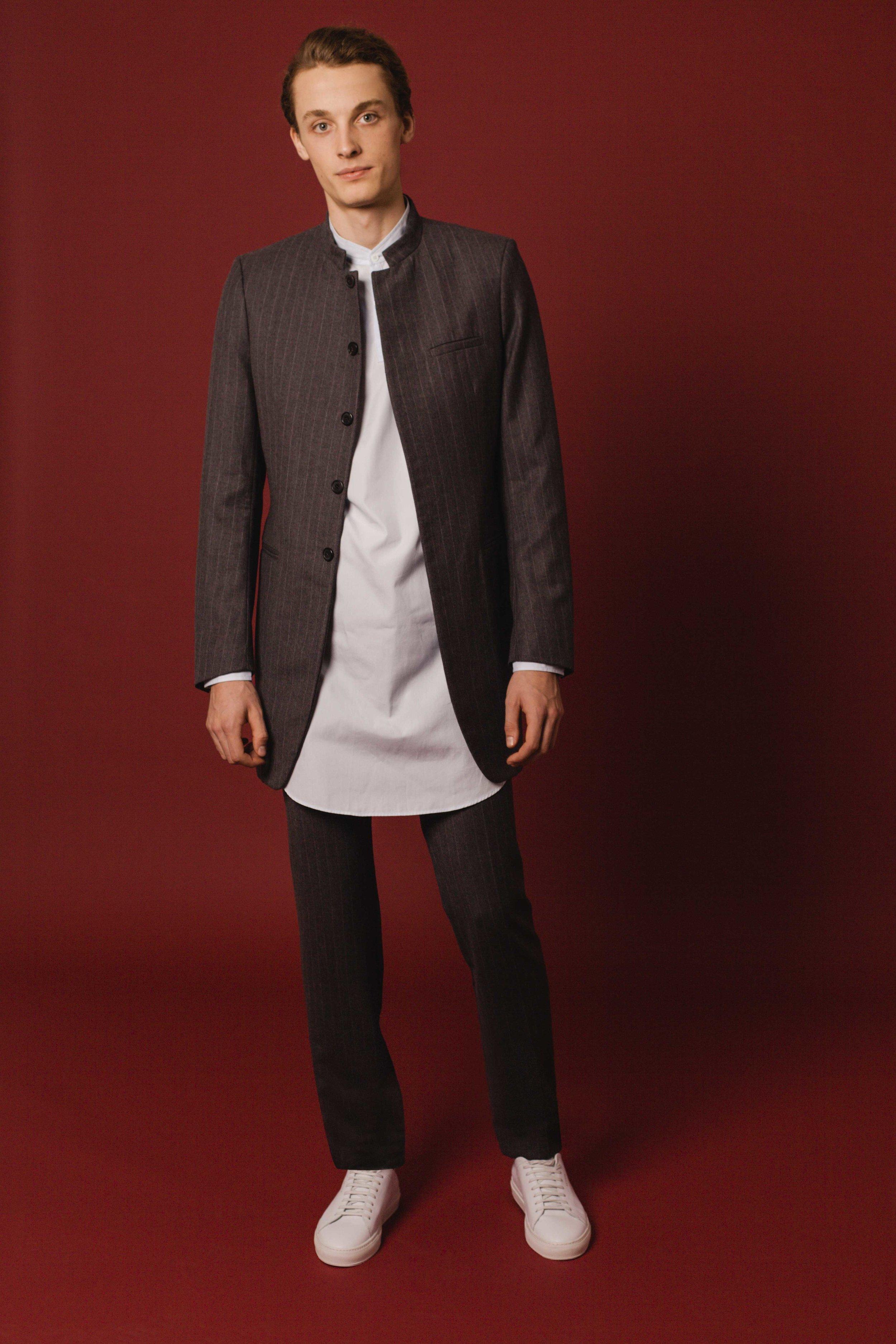 Bombay jacket long grey pinstripe wool Slim fit trousers grey pinstripe wool Made in England  Contemporary shirt long sky blue cotton Made in Italy