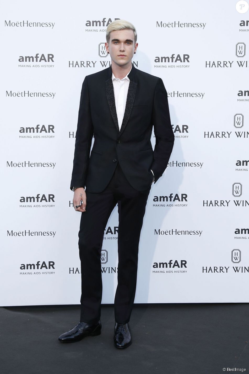 Gabriel Kane Day Lewis in the slim fit trousers paired with a classic shirt and specialcontemporary tuxedo at the amFAR in Paris.