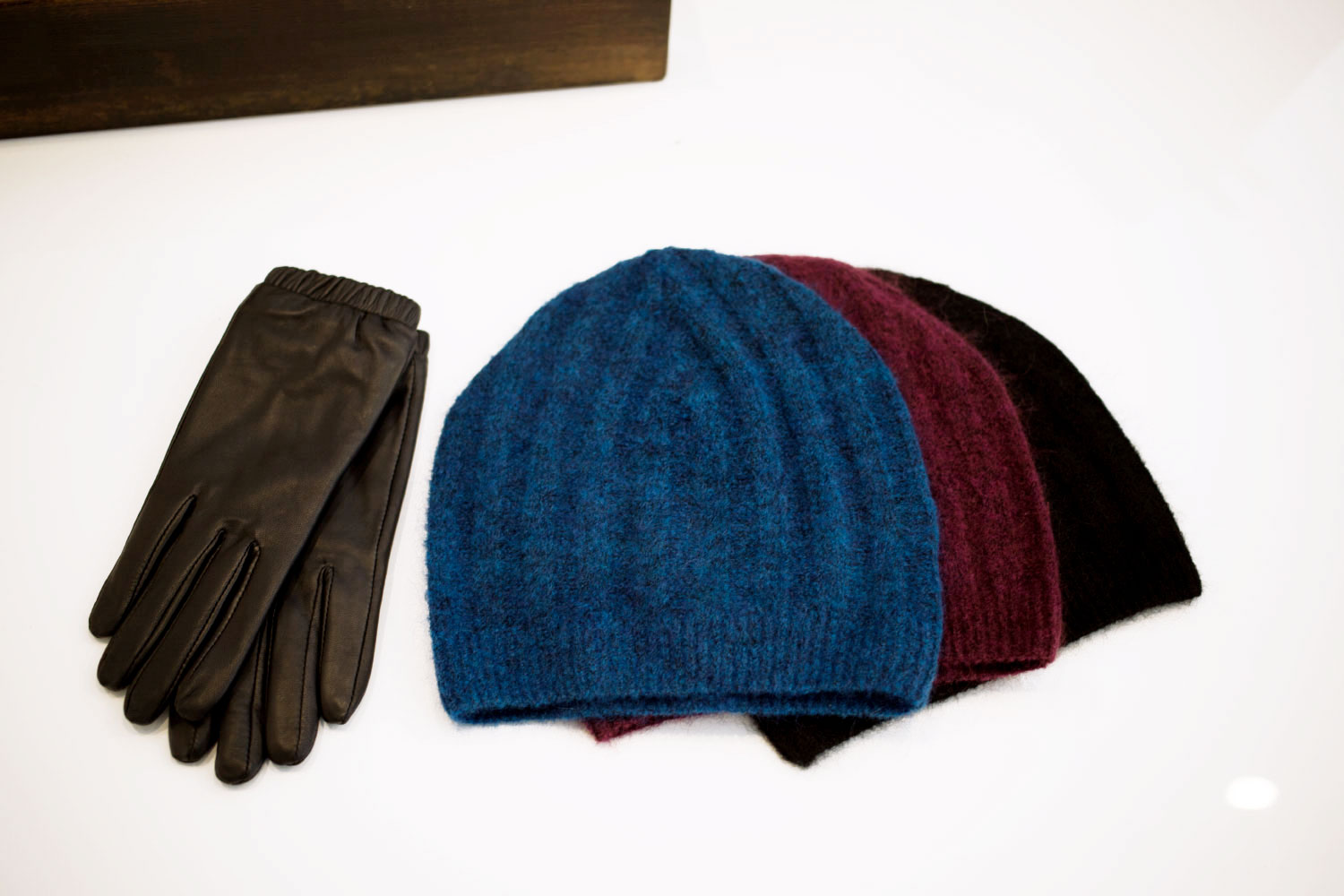 Above:  Just Female Stall Leather Glove s and Glow Beanies in Blue, Aubergine and Black.