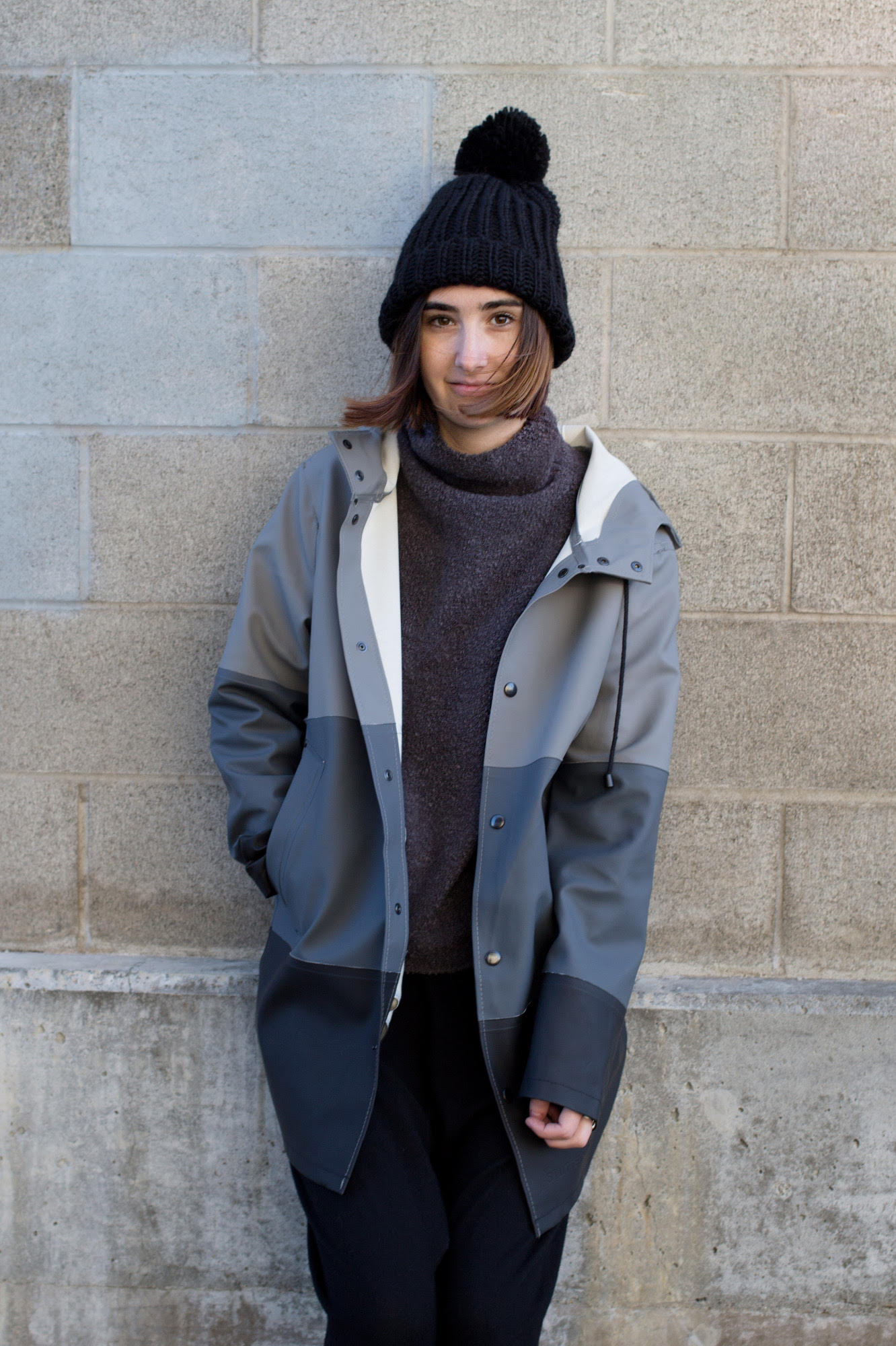 Wearing the Stutterheim  Stockholm Stripe ,  Achro   High Neck Charcoal Sweater  , One Teaspoon  Slouch Pant ,   and Pipe and Row Staples Oversized Pom Beanie.