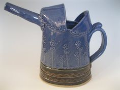ce5709d9eca6a0ed5604ad09b040fc57--watering-cans-ceramic-pottery.jpg