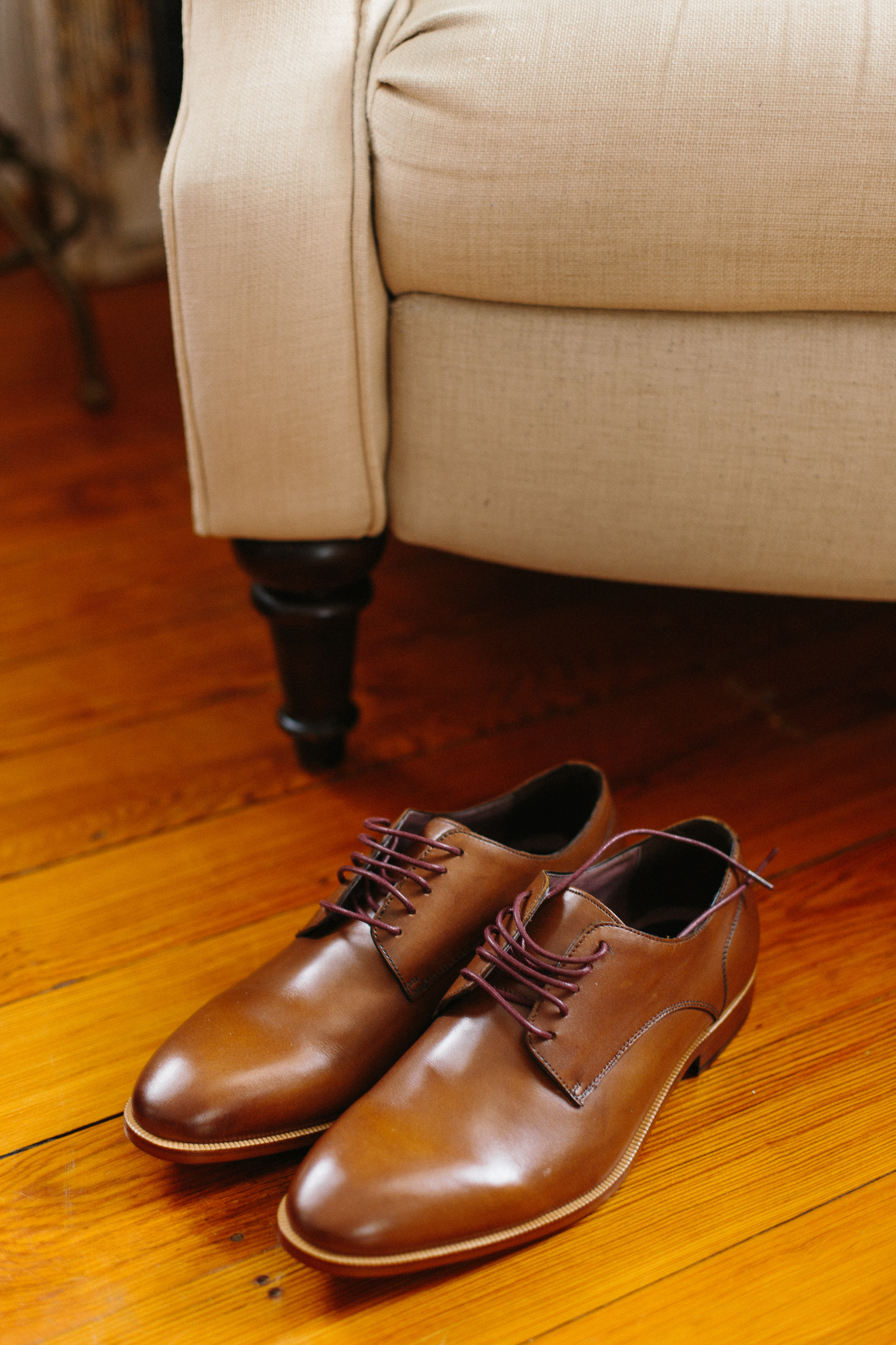 groom-getting-ready-brown-shoes