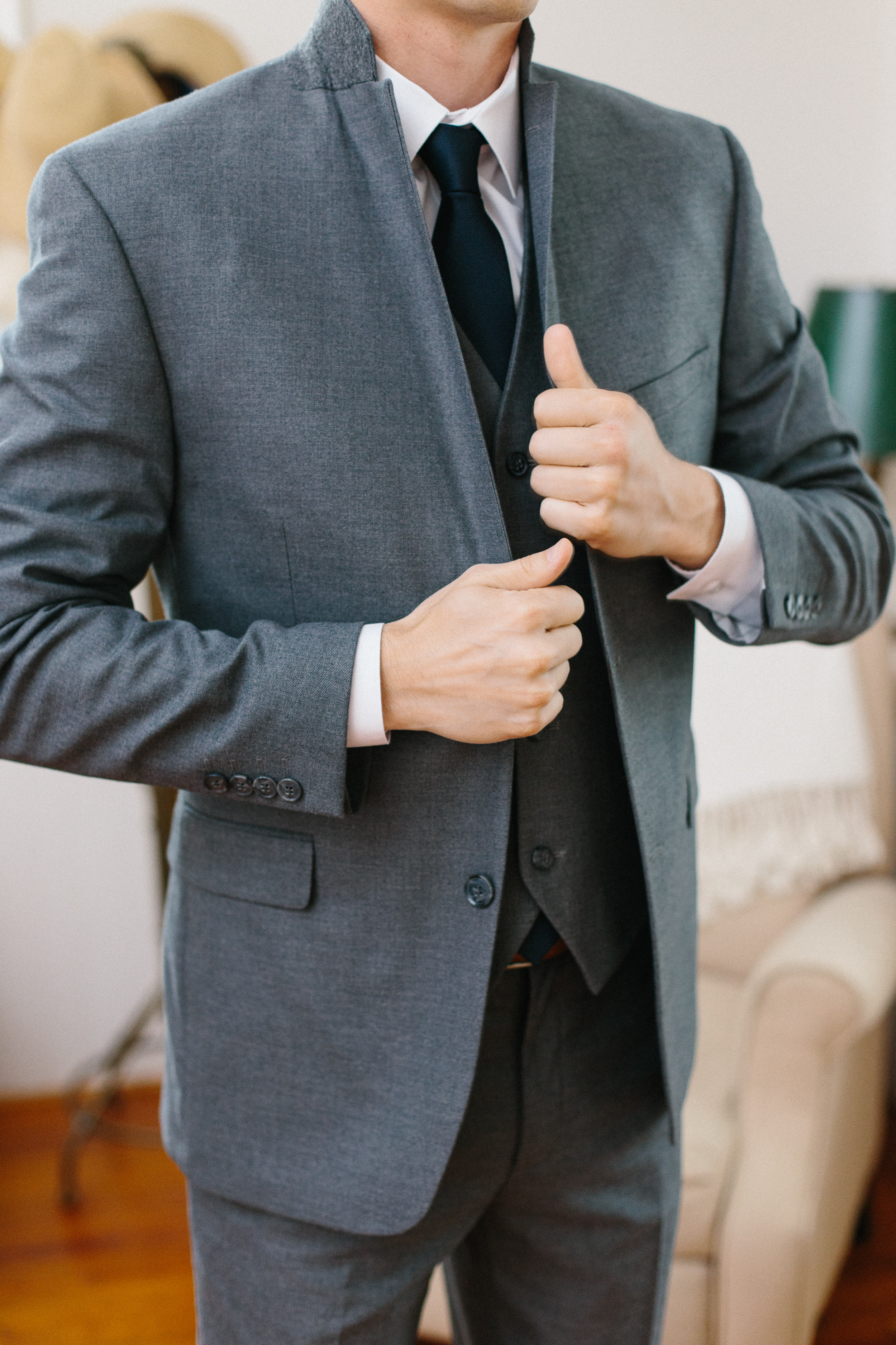 groom-putting-on-jacket-photo
