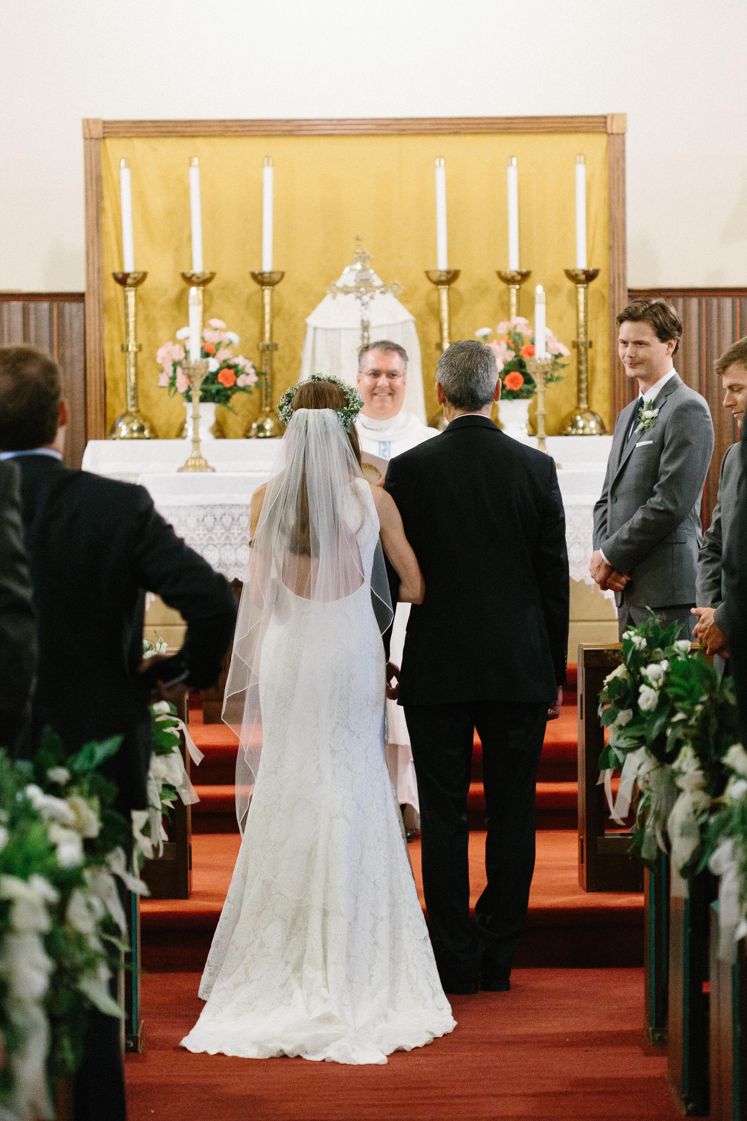 bride-processing-down-the-aisle-catholic-ceremony