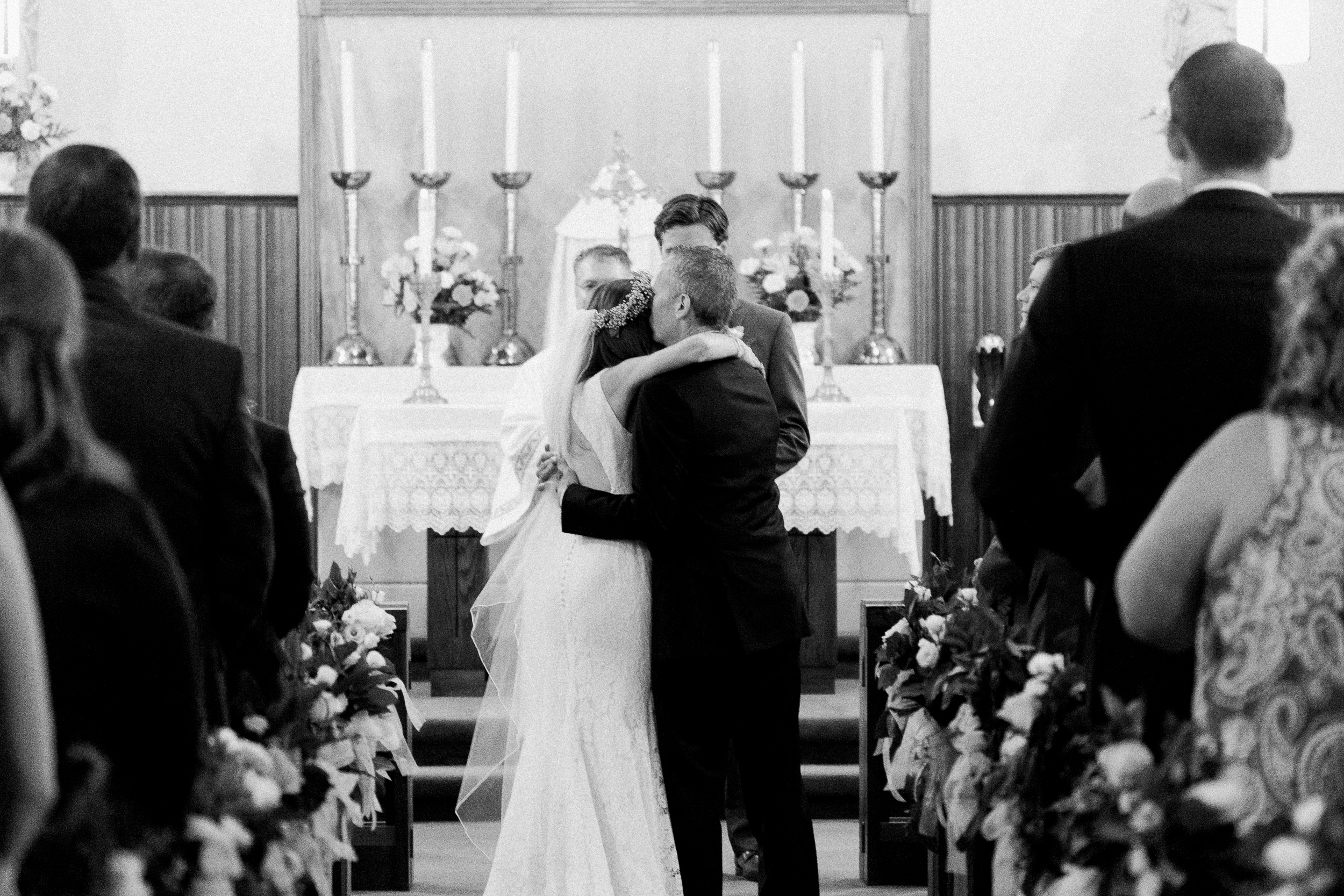 father-of-the-bride-giving-daughter-away-at-ceremony