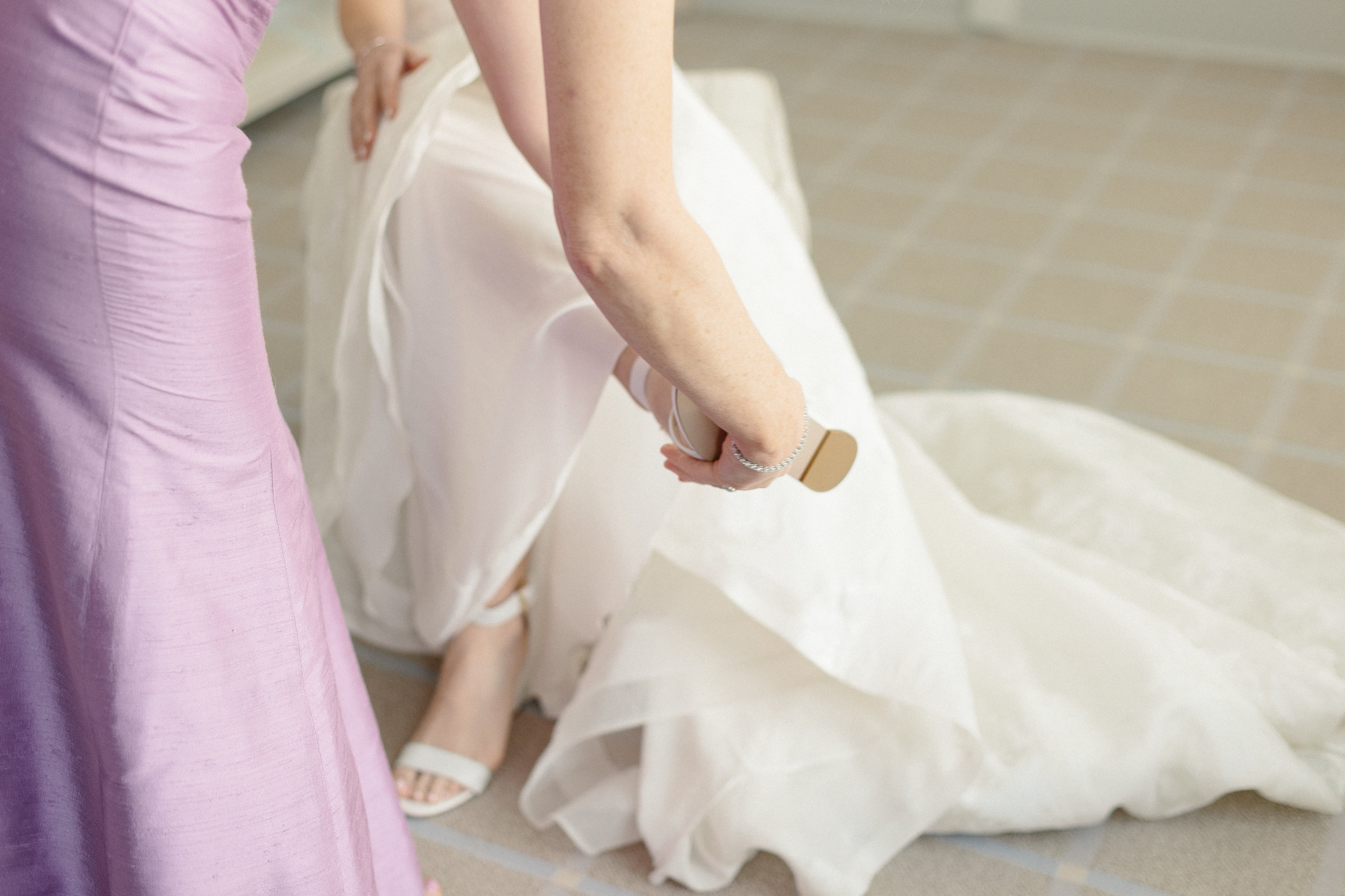 bride-puts-on-shoes-wedding-day-eastern-shore