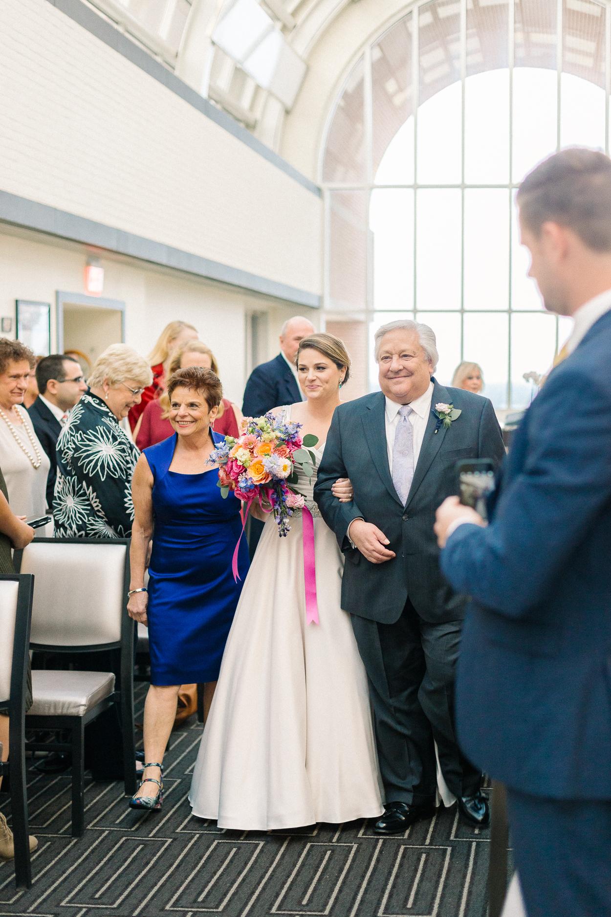 bride-processing-tower-club-wedding-ceremony