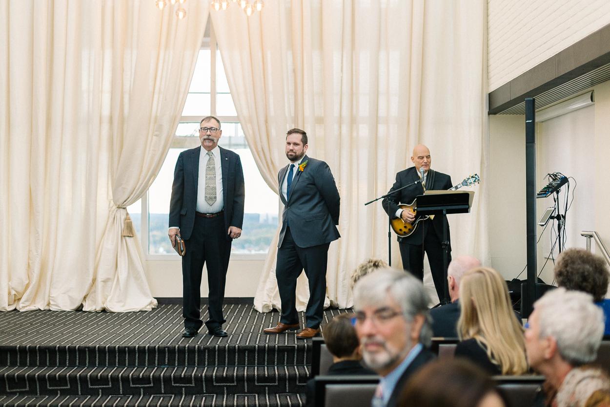 groom-sees-bride-tower-club-wedding-ceremony