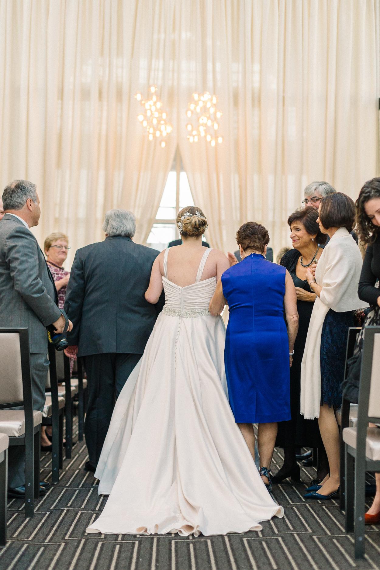 bride-walking-down-aisle-tower-club-wedding