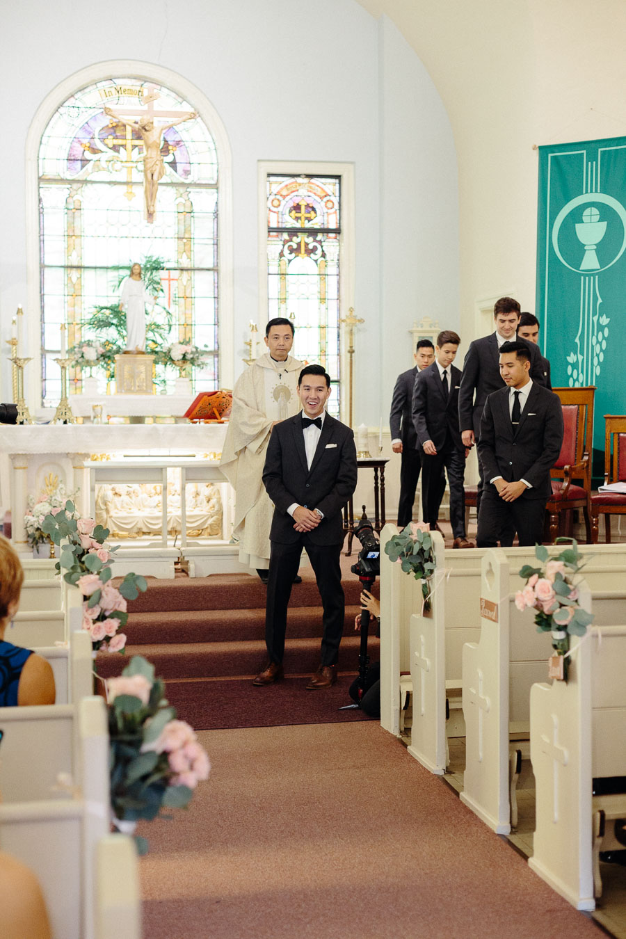 groom-sees-bride-for-first-time-processional-wedding-ceremony