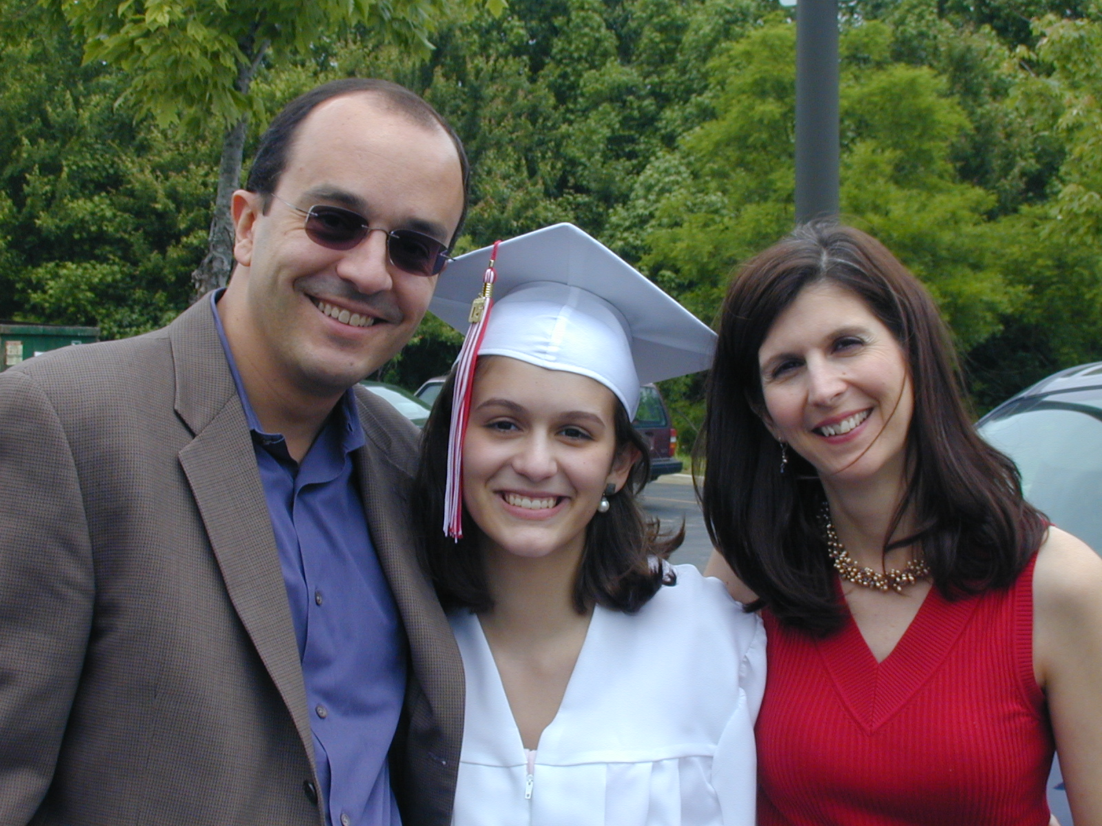 High school graduation: my father, me, and my mother.