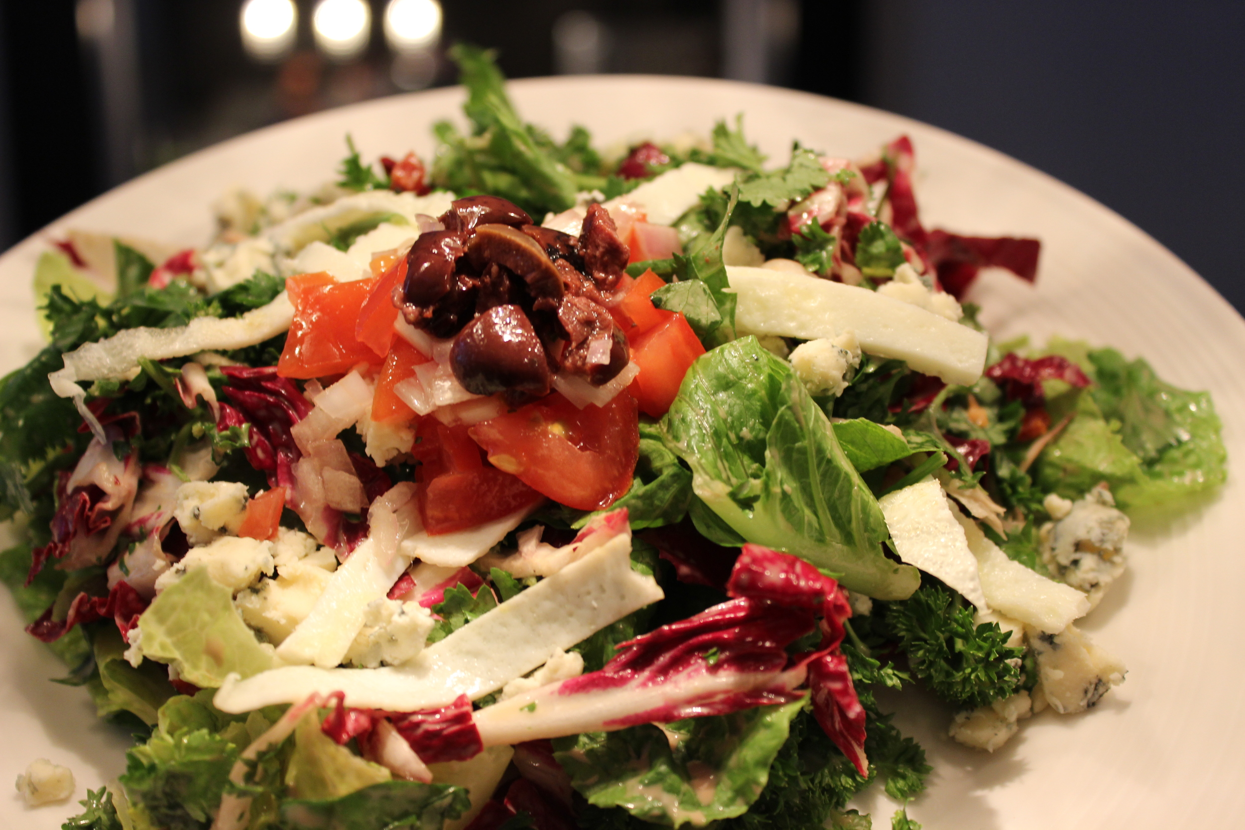 Garden Salad with Blue Cheese and Egg Whites, topped with Fresh Tomato Salsa and Kalamata Olives.