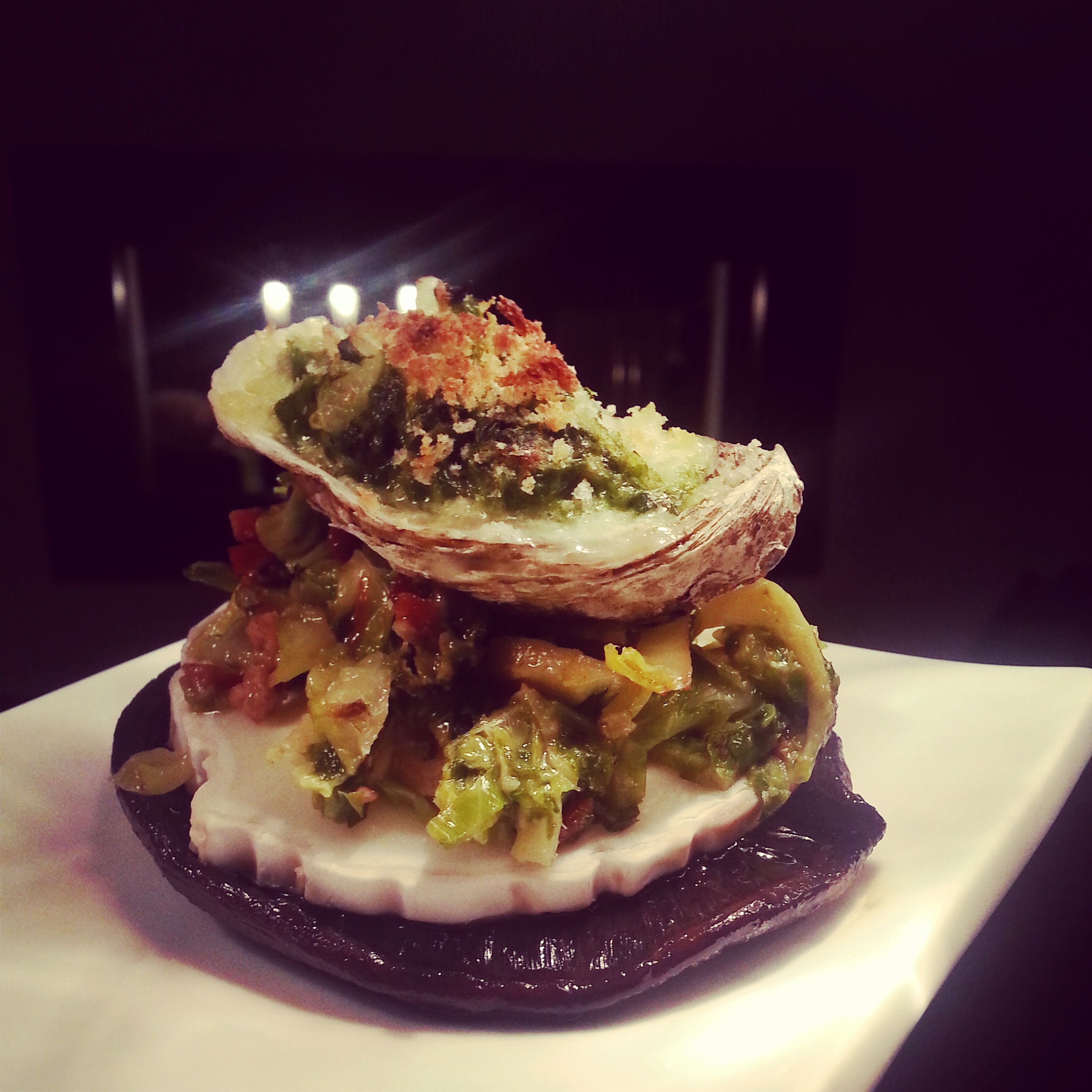 Rockefeller Oyster served on a Brussel Sprout Slaw with a Goat Cheese and Portobello Mushroom base.