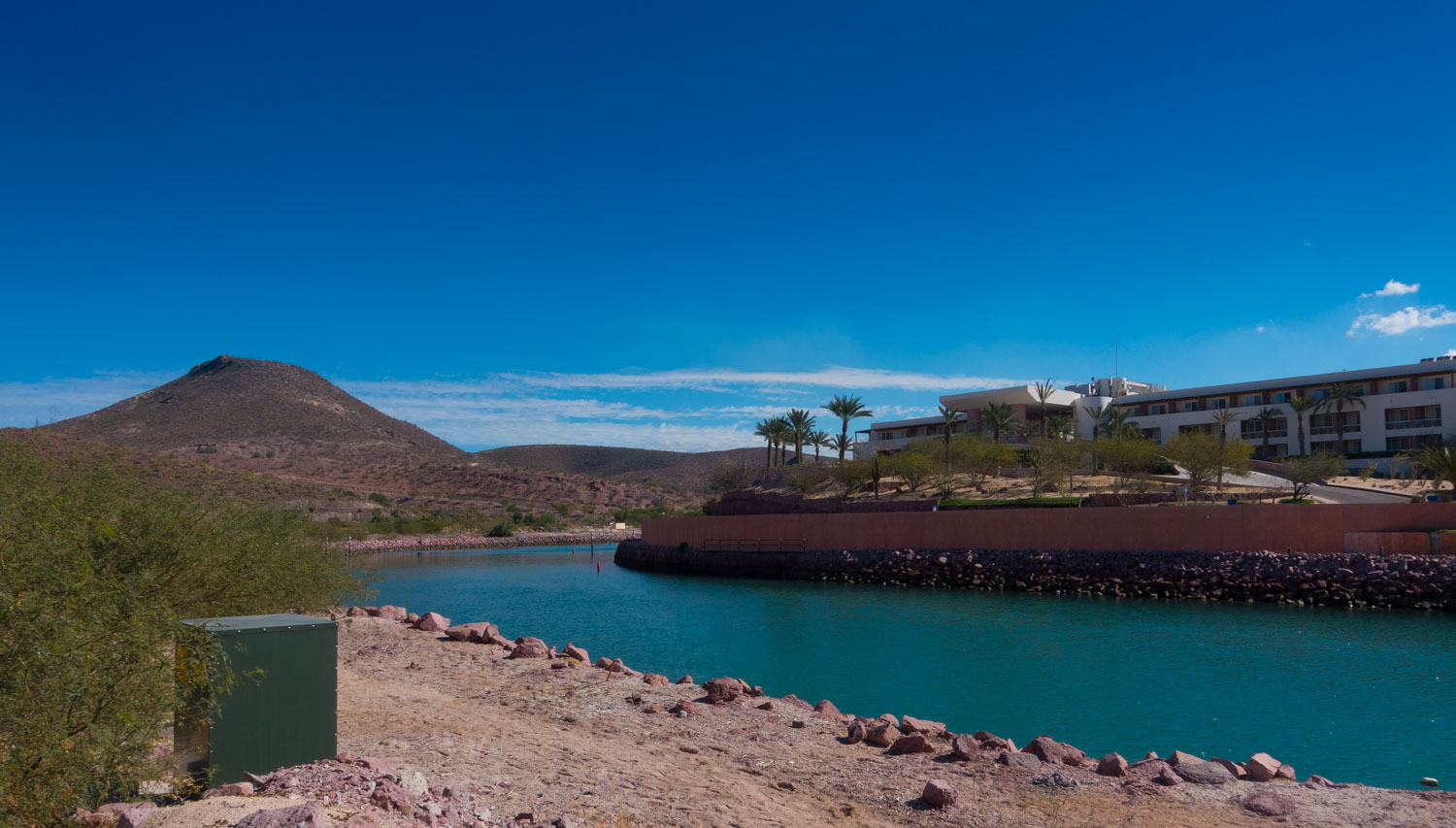 The narrow channel, blasted from the desert that leads to the inner harbor at Costa Baja Marina.