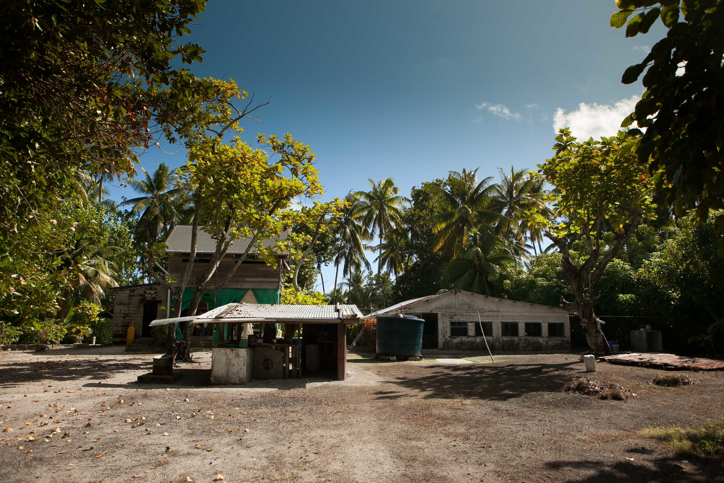 The original house on the right, Tom Neal's former residence, with the ranger's building to the left. Suwarrow, Cook Islands.
