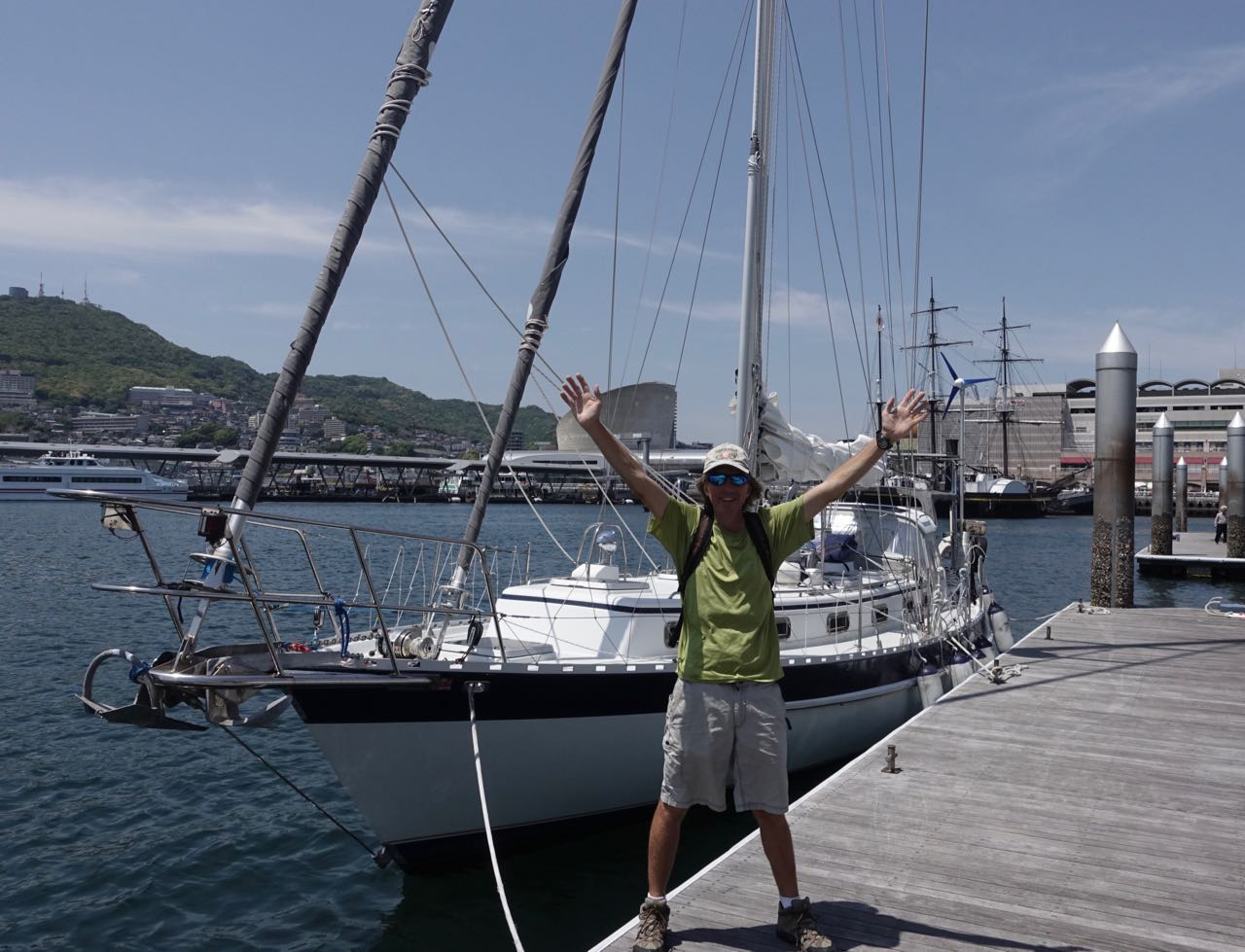 Douglas and Tumbleweed at Dejima Marina with a bit of Nagasaki in the background.