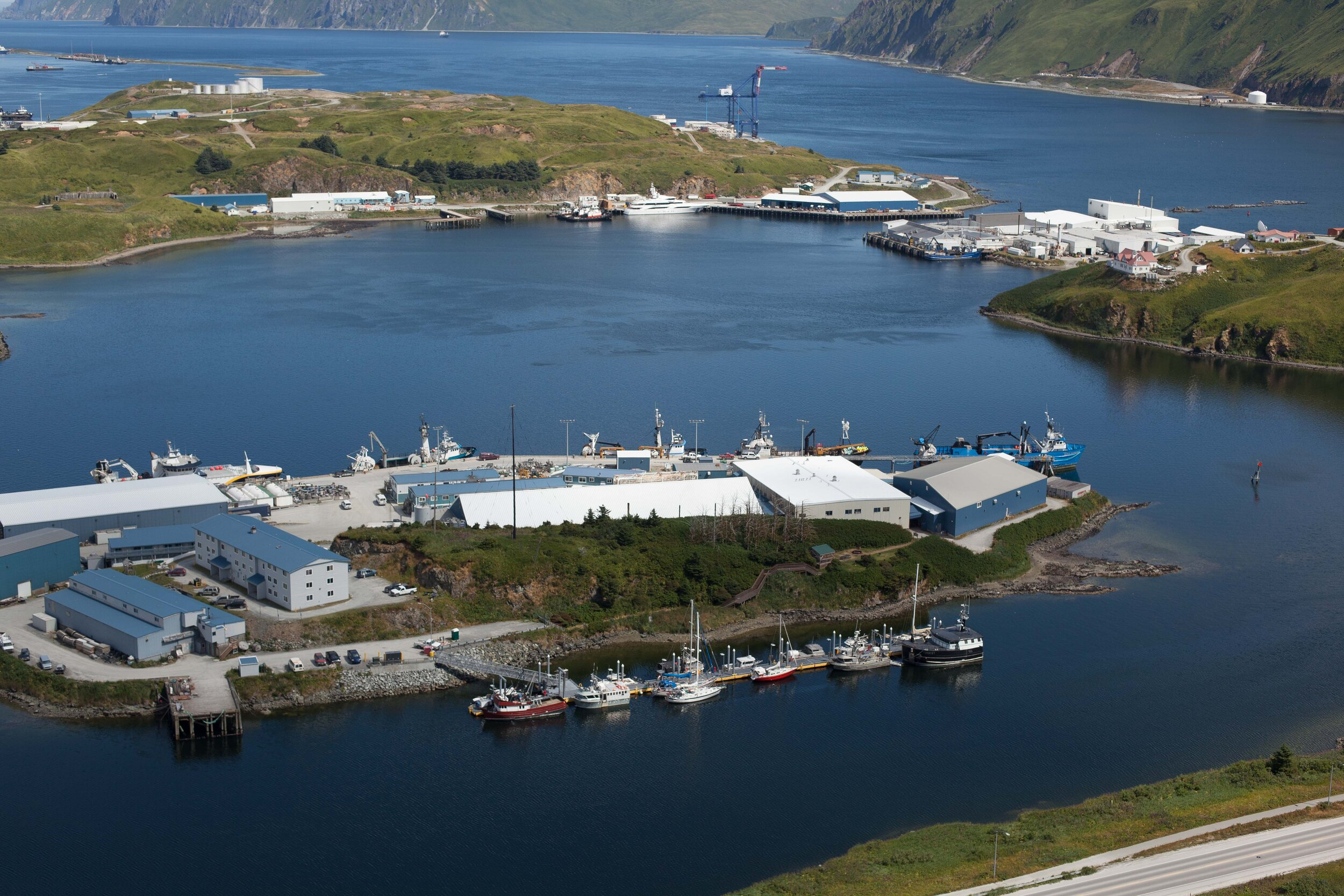 Dutch Harbor's small boat marina from above. Tumbleweed in the center, Nosy Be is the red sailboat just forward of Tumbleweed.