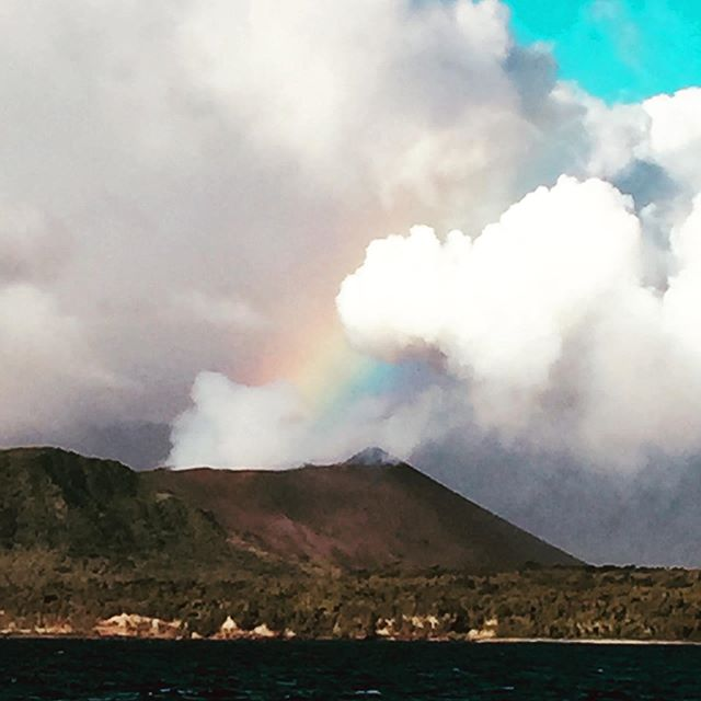 A rainbow flowing into an active volcano bleaching smoke, that's got to be a good sign. Think the gods are appeased!