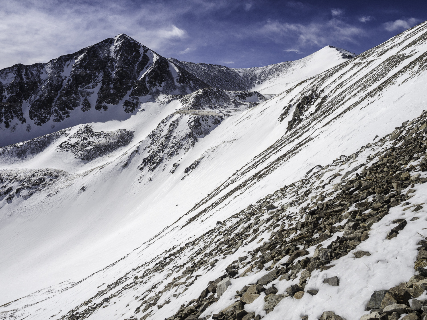 Traversing Peak 10's South Face for Better Skinning Conditions