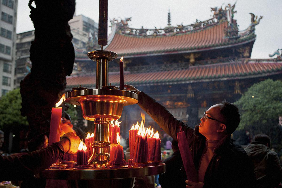 Man Lighting Candle in Taipei