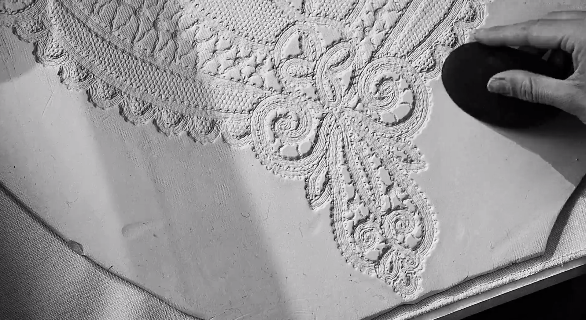 A still of me working on the porcelain lace cape from the craft processes video. The Cape Reimagined shows some of the processes behind the capes, watch fleeting glimpses of me working in the viedos  here .