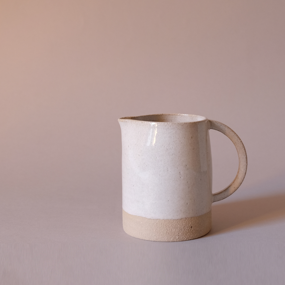 Stoneware jug made for a Mother's Day gift.The off-white glaze has blues and pink coming through.