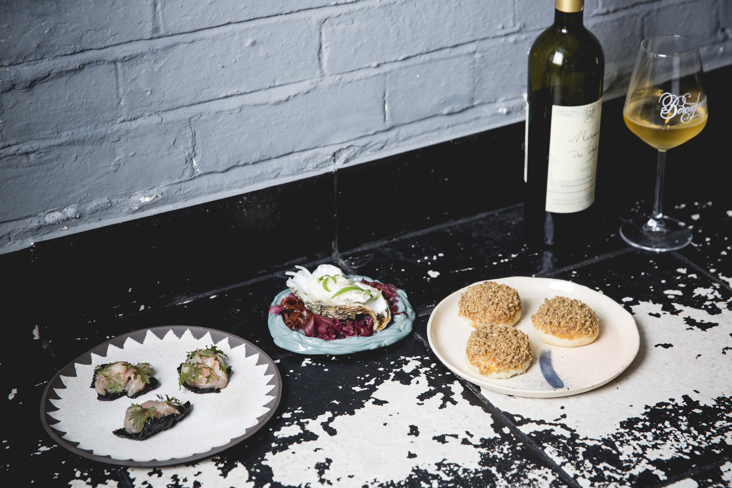 Three of the courses with one of Borough Wine's paired wines. Plates by Lazy Glaze, Hackney Potter and Victoria Bridal.