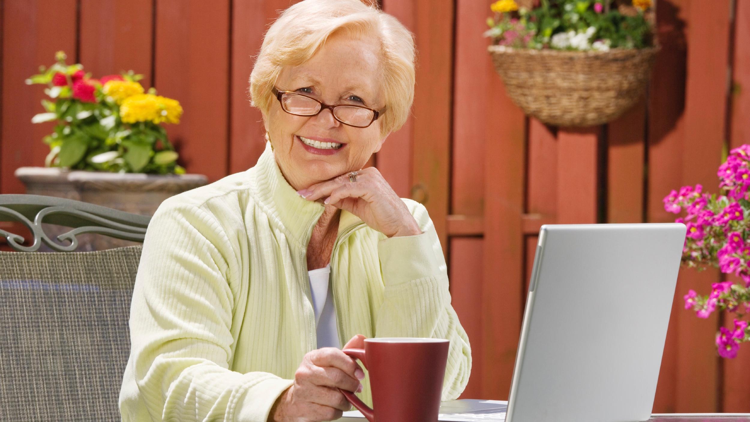 Senior outside with laptop.jpg