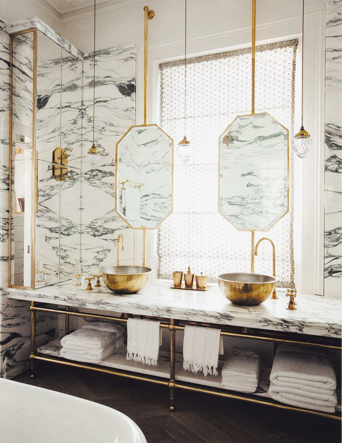 marble and gold metal washstand sink