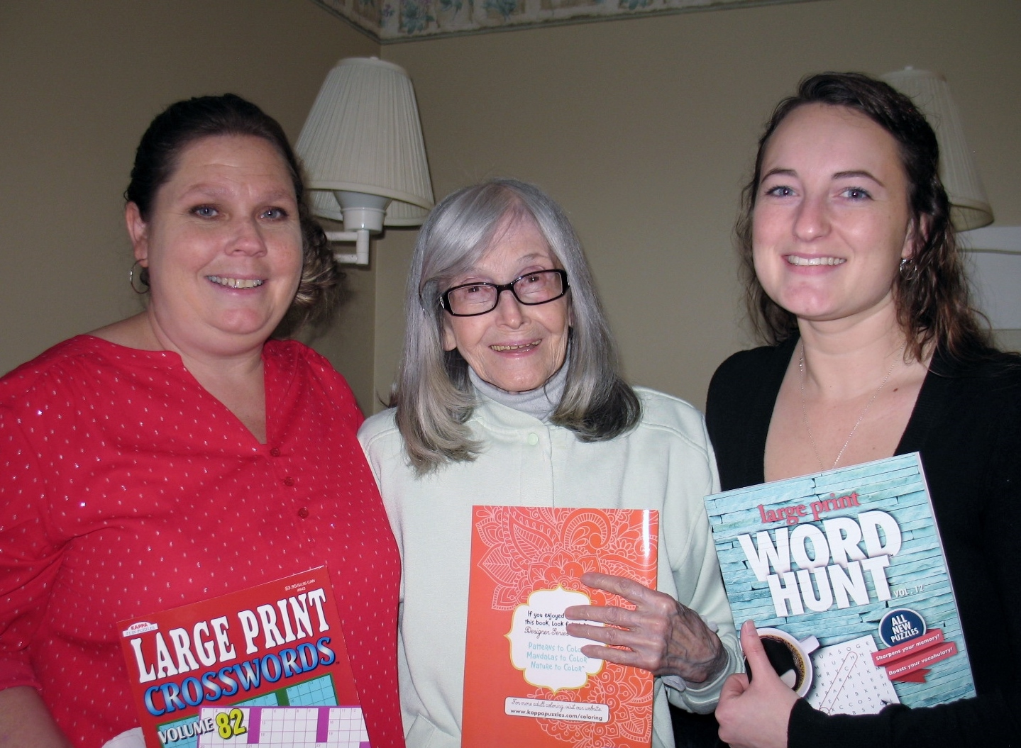 Elf helpers Verna and Amy deliver one of many books to Rose