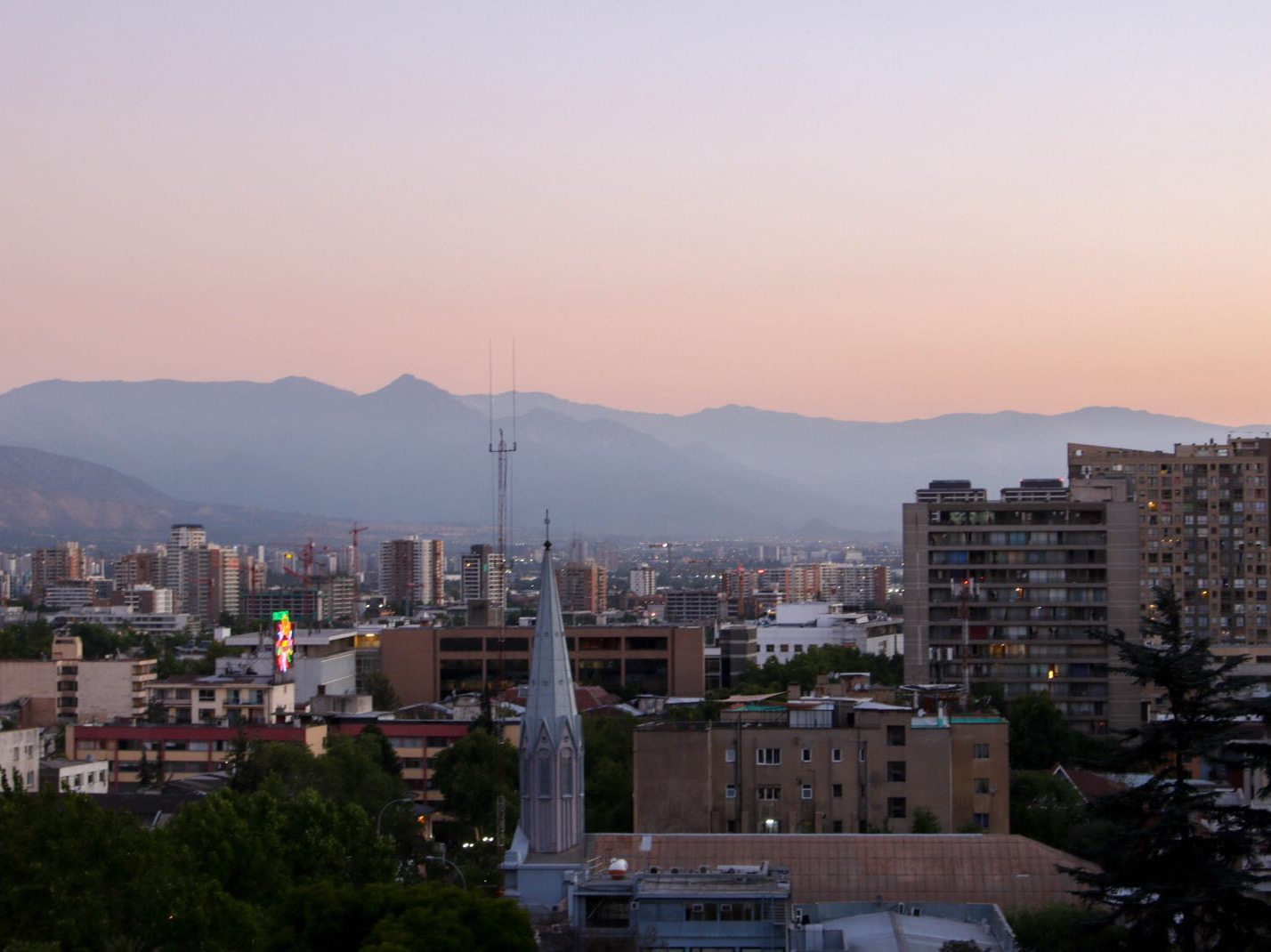 Sunset over Santiago (and the view from our apartment).