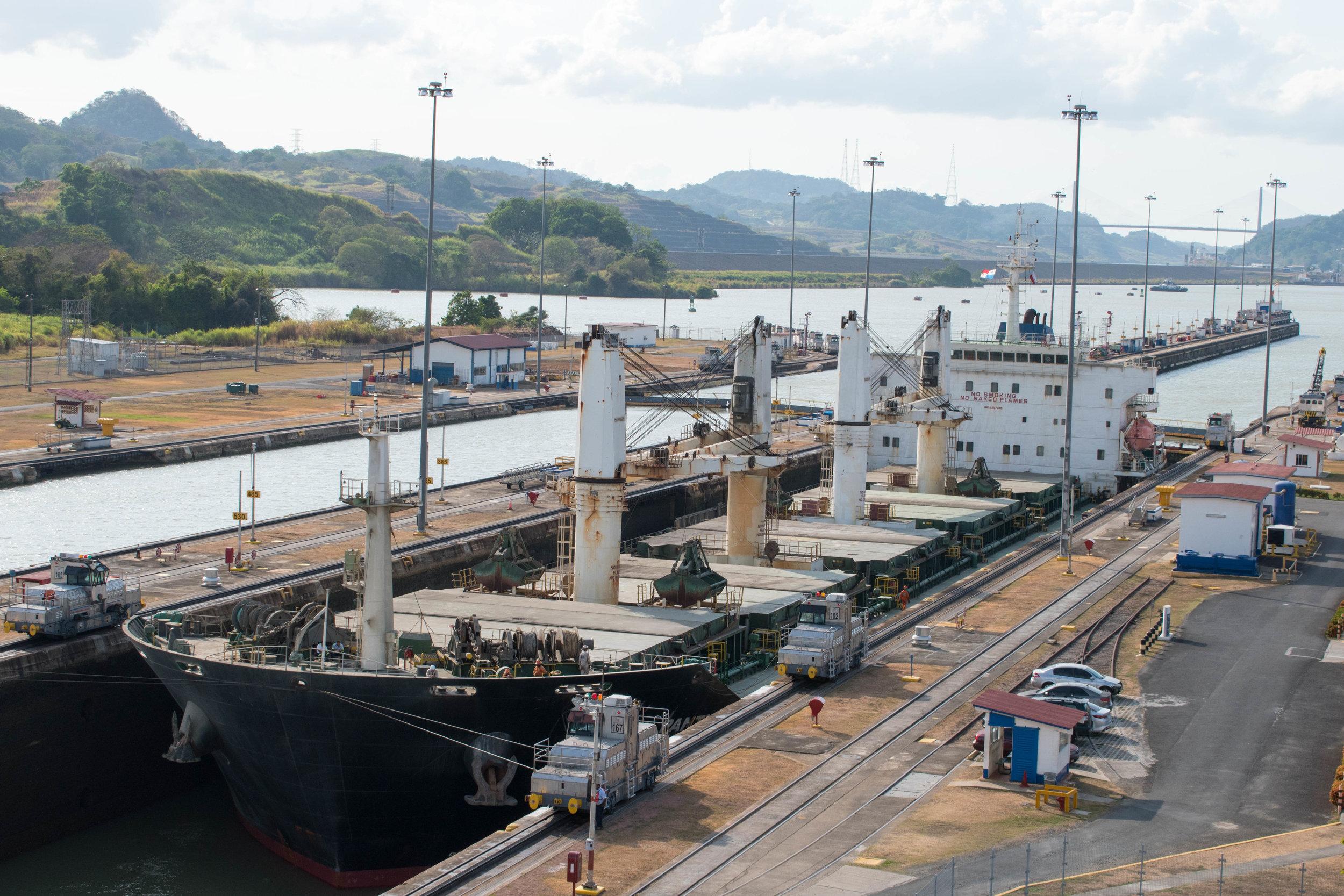 Imposing Cargo Ships Pass Through The Panama Canal