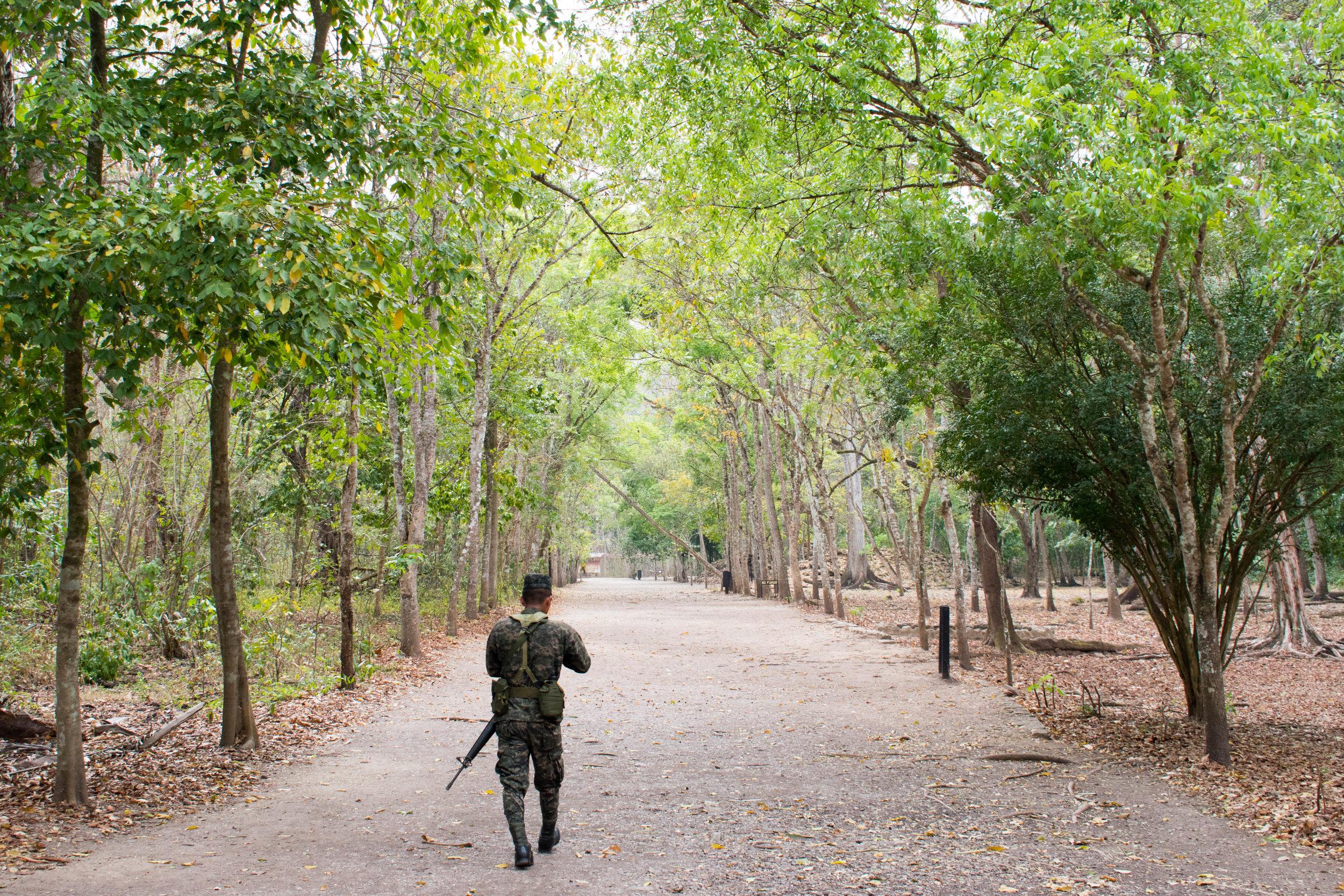 An Armed Guard Patrols the Ruins of Copán in Honduras