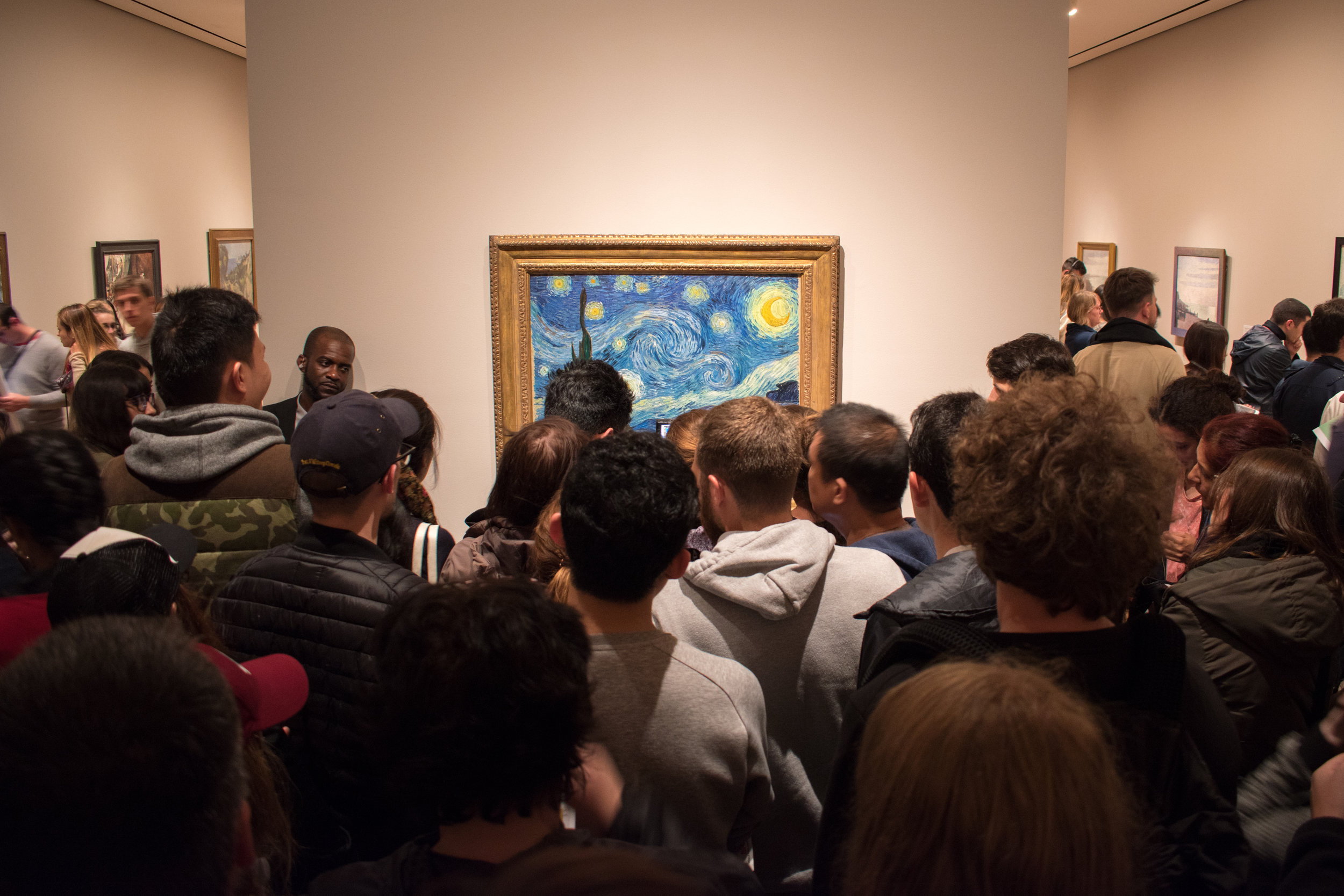 Hoards Gather To Glimpse Van Gogh's Starry Night in the MoMA