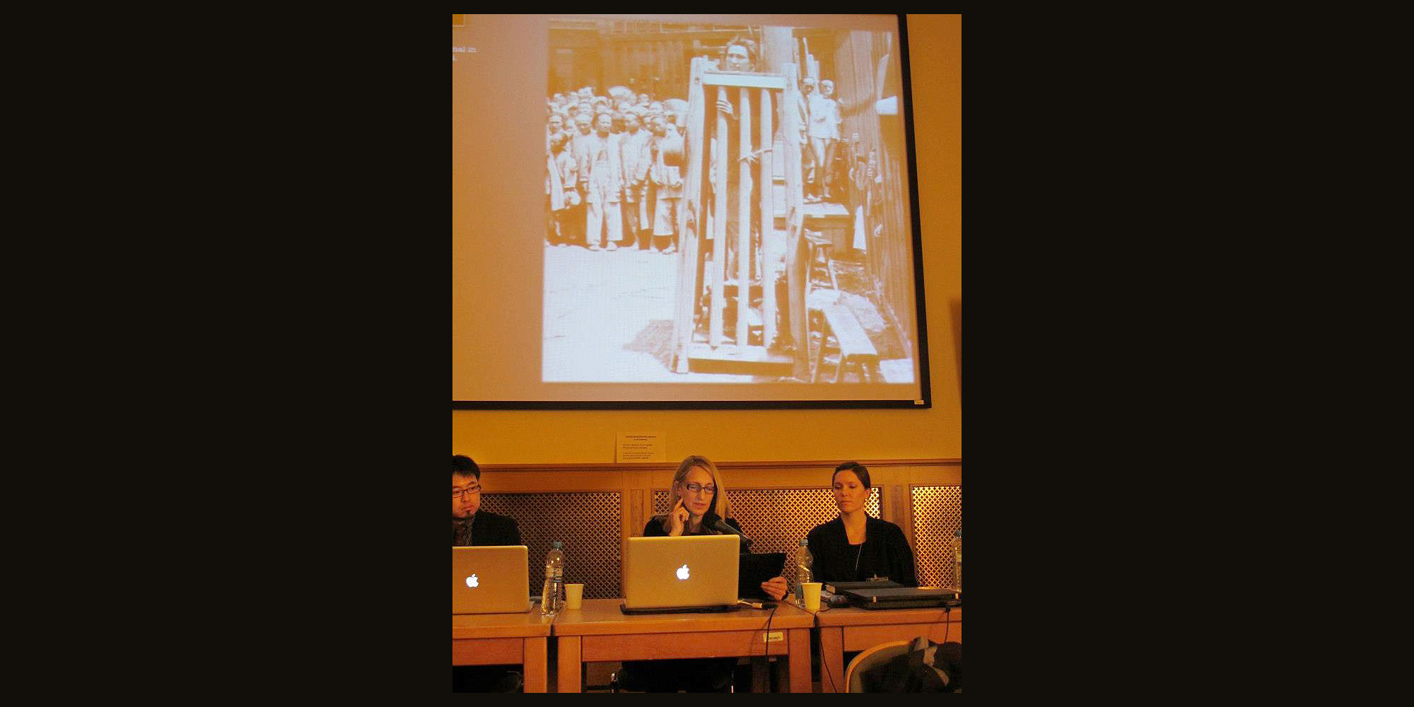 "Presenting the paper, ""Atmosphere: Disorientation in Visual Narrative as a Time Traveler's Tool,"" MutaMorphosis Conference, Academy of Sciences, Prague (Dec. 6-8, 2012). Ellen Sebring, photo by Blanka Domagalska."