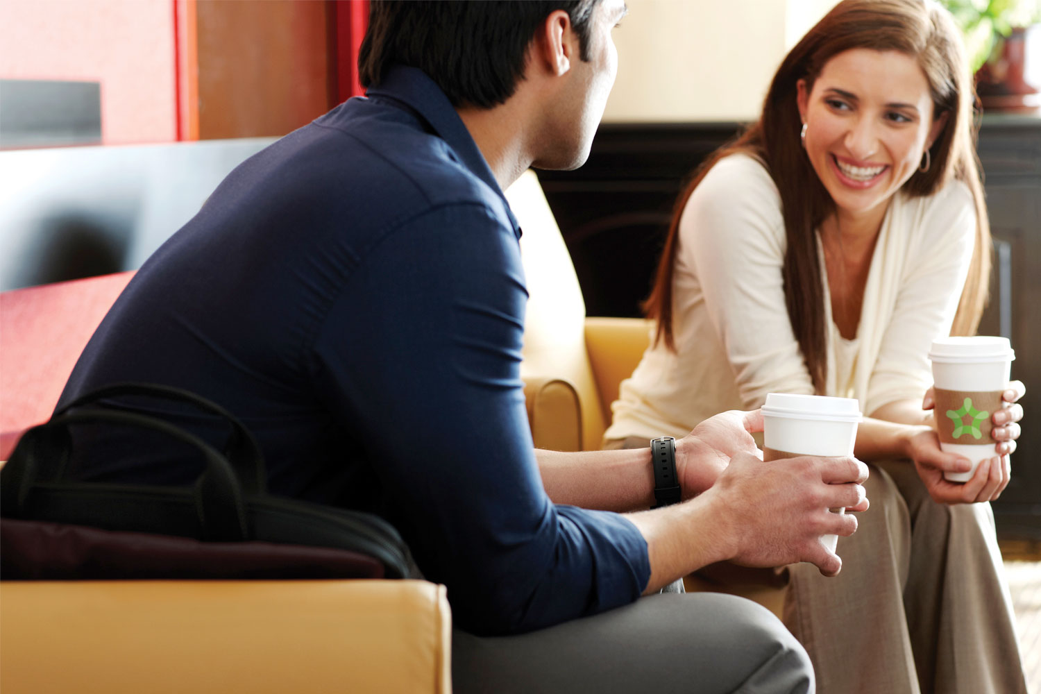 Guests enjoying the Extended Stay America lobby and complimentary coffee